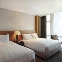 Lotte City Hotel Jeju 4* Улучшенный номер с различными типами кроватей фото 4