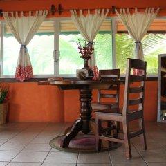Отель Bungalows Tree Tops Мексика, Коакоюл - отзывы, цены и фото номеров - забронировать отель Bungalows Tree Tops онлайн интерьер отеля