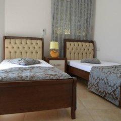 Отель Riza Hotel Албания, Тирана - отзывы, цены и фото номеров - забронировать отель Riza Hotel онлайн комната для гостей фото 3