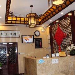Отель Chinese Culture Holiday Hotel - Nanluoguxiang Китай, Пекин - отзывы, цены и фото номеров - забронировать отель Chinese Culture Holiday Hotel - Nanluoguxiang онлайн интерьер отеля фото 3