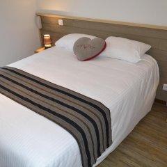 Отель Citotel L'Echo Des Montagnes Армой комната для гостей