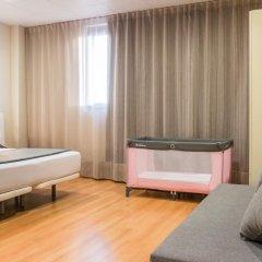 Отель Vertice Roomspace Madrid 3* Стандартный семейный номер с различными типами кроватей