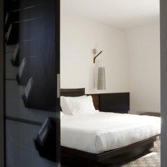Отель NH Milano Touring 4* Улучшенный номер разные типы кроватей фото 44