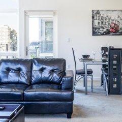 Апартаменты Heaven on Washington Furnished Apartments комната для гостей фото 3