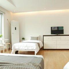 Отель The Mei Haus Hongdae 3* Стандартный семейный номер с двуспальной кроватью фото 7
