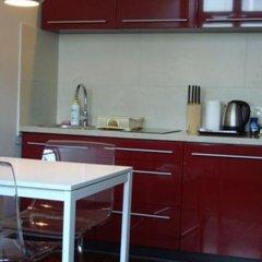 Апартаменты Home & Travel Apartments удобства в номере фото 2