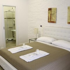 Отель Attico Luxury B&B Капуя комната для гостей фото 3