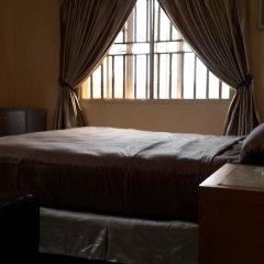 Отель Mikagn Hotel And Suites Нигерия, Ибадан - отзывы, цены и фото номеров - забронировать отель Mikagn Hotel And Suites онлайн комната для гостей фото 3