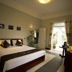 Отель The Moon Villa Hoi An 2* Стандартный семейный номер с различными типами кроватей фото 28