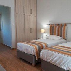 Отель Olive Grove Resort сейф в номере