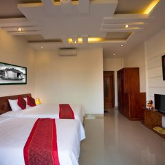 Отель Hoang Thu Homestay 2* Стандартный семейный номер с двуспальной кроватью фото 5