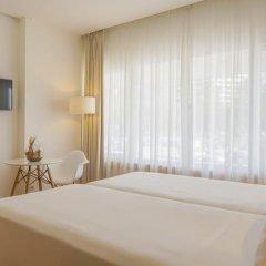 Отель NH Lisboa Campo Grande Стандартный номер с различными типами кроватей фото 5