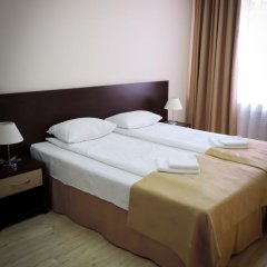 Гостиница Inn Ordzhonikidze 8а Семейный люкс с 2 отдельными кроватями фото 10