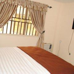 Отель Mikagn Hotel And Suites Нигерия, Ибадан - отзывы, цены и фото номеров - забронировать отель Mikagn Hotel And Suites онлайн комната для гостей фото 2
