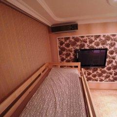 Гостиница Майкоп Сити Кровать в женском общем номере с двухъярусной кроватью фото 10
