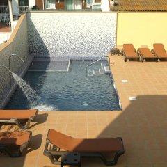 Отель Apartamentos Neptuno бассейн