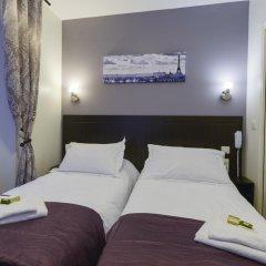 Отель Hôtel du Quai de Seine 2* Стандартный номер с различными типами кроватей фото 11