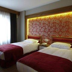 Отель Bella Стандартный номер с двуспальной кроватью фото 4