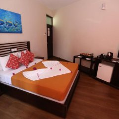 Hikkaduwa Beach Hotel удобства в номере
