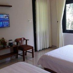 Отель CoCo Riverside Homestay удобства в номере