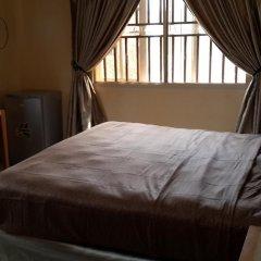 Отель Mikagn Hotel And Suites Нигерия, Ибадан - отзывы, цены и фото номеров - забронировать отель Mikagn Hotel And Suites онлайн комната для гостей фото 4