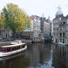 Отель Old City Centre apartments - Damrak building Нидерланды, Амстердам - отзывы, цены и фото номеров - забронировать отель Old City Centre apartments - Damrak building онлайн приотельная территория