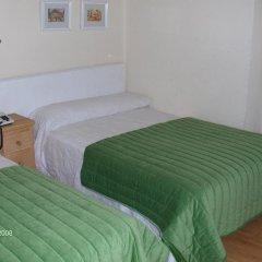 Отель Hostal Riesco Стандартный номер с различными типами кроватей фото 8