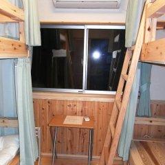 Отель Guesthouse Yakushima 2* Кровать в женском общем номере фото 5
