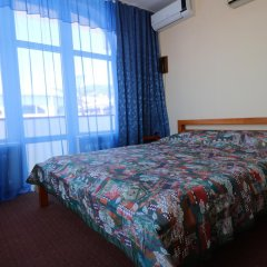 Гостиница Бриз комната для гостей фото 3