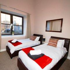 Отель Terracotta - Glasgow City Centre Apartment Великобритания, Глазго - отзывы, цены и фото номеров - забронировать отель Terracotta - Glasgow City Centre Apartment онлайн комната для гостей фото 4