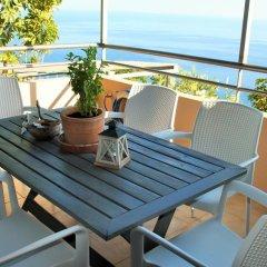 Отель Anemos Luxury Villas балкон