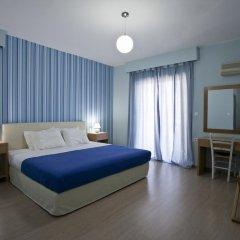 Отель Valente Perlia Rooms Греция, Порос - отзывы, цены и фото номеров - забронировать отель Valente Perlia Rooms онлайн комната для гостей