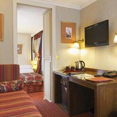 Отель Hôtel Au Manoir St-Germain des Prés 4* Улучшенный номер с различными типами кроватей фото 3