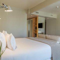 Отель NH Collection Lisboa Liberdade 4* Стандартный номер с разными типами кроватей фото 4