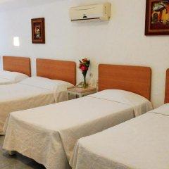 Hotel Olinalá Diamante 3* Стандартный семейный номер с двуспальной кроватью фото 3