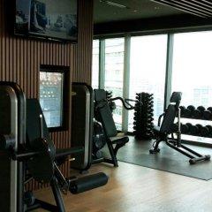 Отель Pan Pacific Serviced Suites Beach Road, Singapore фитнесс-зал фото 4