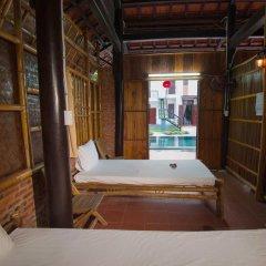 Отель Tra Que Flower Homestay Кровать в общем номере с двухъярусной кроватью фото 2