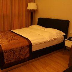 Апартаменты Lasony Serviced Apartment Стандартный номер с различными типами кроватей
