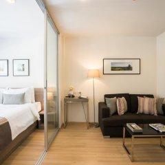 Отель The Grass Serviced Suites by At Mind Люкс с различными типами кроватей