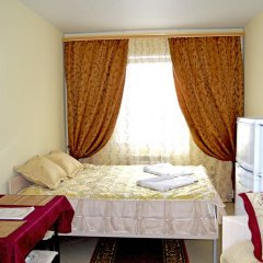 Гостиница Home Стандартный семейный номер с разными типами кроватей фото 6