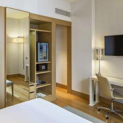 Отель NH Milano Touring 4* Улучшенный номер разные типы кроватей фото 11