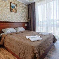 Mini-Hotel Tri Art Стандартный семейный номер с двуспальной кроватью фото 2