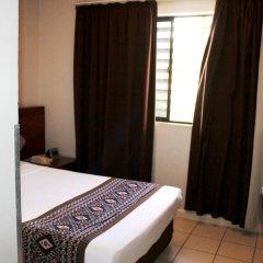 Отель Smugglers Cove Beach Resort and Hotel Фиджи, Вити-Леву - отзывы, цены и фото номеров - забронировать отель Smugglers Cove Beach Resort and Hotel онлайн комната для гостей фото 4