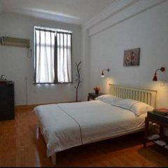 Chengdu Traffic Youth Hostel Стандартный номер с двуспальной кроватью (общая ванная комната) фото 3