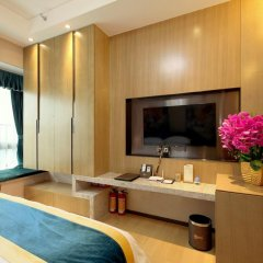 Апартаменты Guangzhou Chimelong Heefun International Service Apartment Номер Делюкс фото 4
