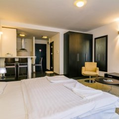 Апартаменты City Gardens Apartments комната для гостей