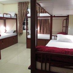 Отель Travelers Home Кровать в общем номере