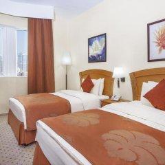 Отель Golden Tulip Sharjah Представительский люкс с различными типами кроватей фото 7