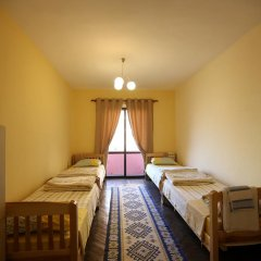 Cosy Hostel Tirana Кровать в общем номере с двухъярусной кроватью фото 2
