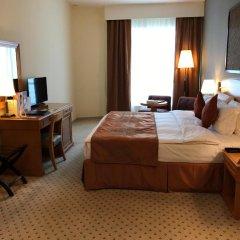 Отель Golden Tulip Sharjah Представительский номер с различными типами кроватей фото 3